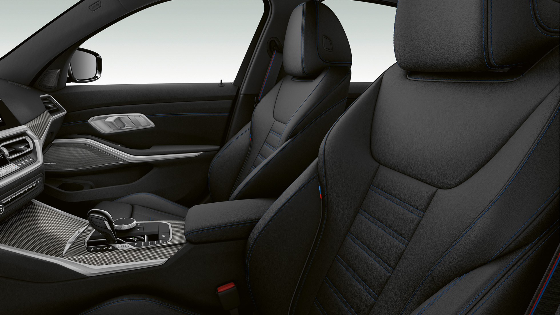 Side close-up of the front seats of the BMW 3 Series M340i xDrive Sedan.